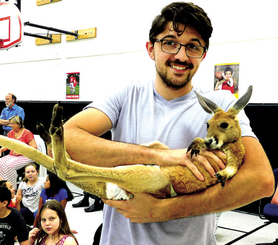 The Inter-Mountain photo by Lydia Rhodes Third Ward Elementary School students and teachers were intrigued Wednesday afternoon during an assembly featuring exotic animals from all over the world. The visiting presenters are employees of Barn Hill Preserve near Baton Rouge, Louisiana, who are known for their educational animal programs. Students were educated on multiple animals including a ball python, bearded dragon, southern three-banded armadillo and a red kangaroo. Barn Hill Preserve's Michael Budetti, above, released the kangaroo to roam among eager students.