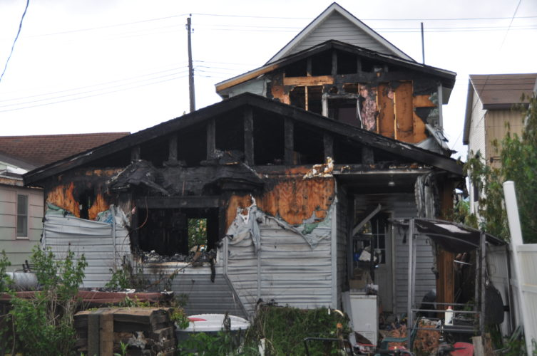The Inter-Mountain photo by Tim MacVean A Livingston Avenue residence sustained severe damage after a fire during the early morning hours Thursday.