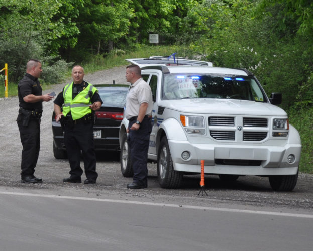 The Inter-Mountain photo by Tim MacVean Chief Deputy B.M. Carpenter, of the Barbour County Sheriff's Department, speaks with officers on scene in Barbour County following an explosion at Midland Resource Recovery.