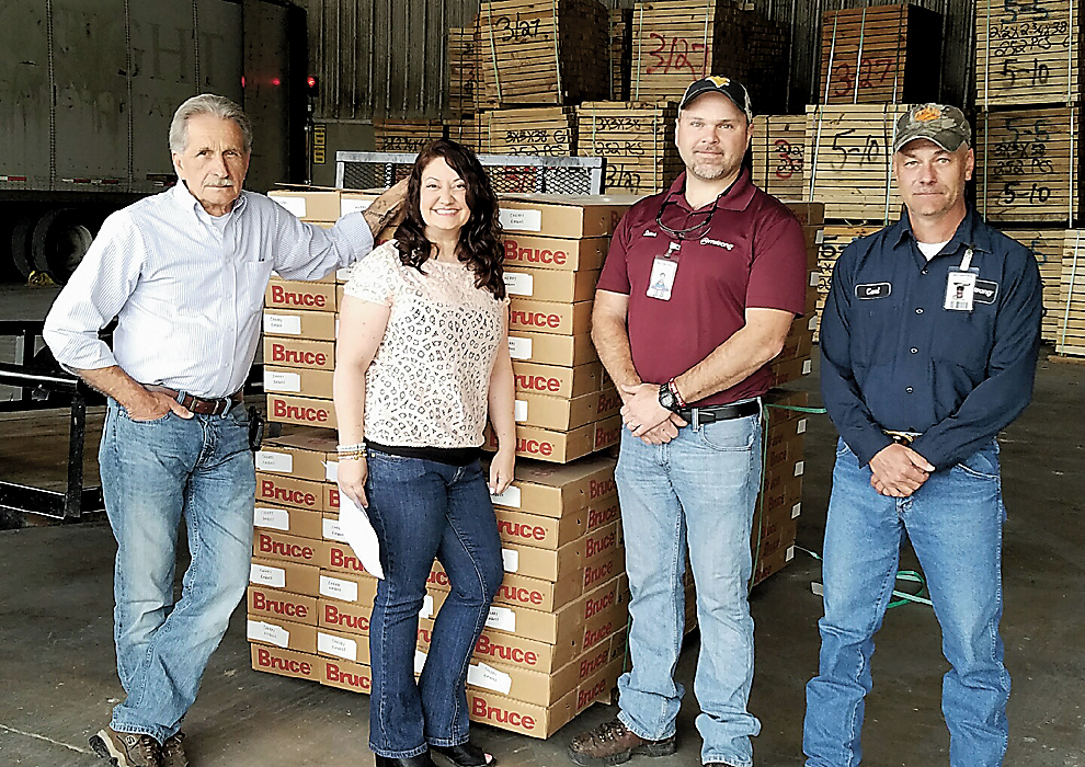 Submitted photo Armstrong Flooring makes a donation of embossed cherry wood  flooring that will be used - Armstrong Gives To Autism Supportive Center News, Sports, Jobs