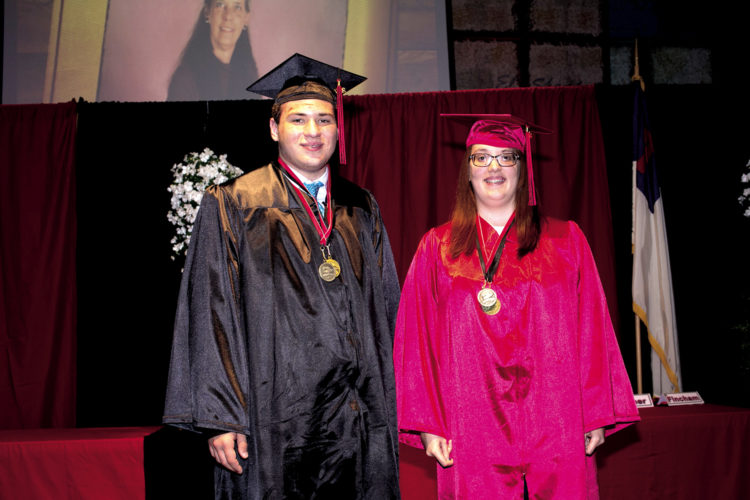 The Inter-Mountain photo by Kevin Hostetler Seniors Noah Wingfield and Camela Tallman graduated from Elkins Christian Academy on Thursday night. Paul Rankin, owner of Chik-fil-a in the Meadowbrook Mall, was the guest speaker.