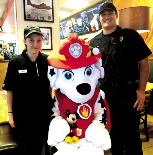 The Inter-Mountain photo by Kristi Groves The Paw Patrol and local emergency services personnel visited with local children Thursday night at McDonald's on the Beverly Five-lane. The event promoted safety, and 20 percent of sales during the two-hour event were donated to the police and fire department.