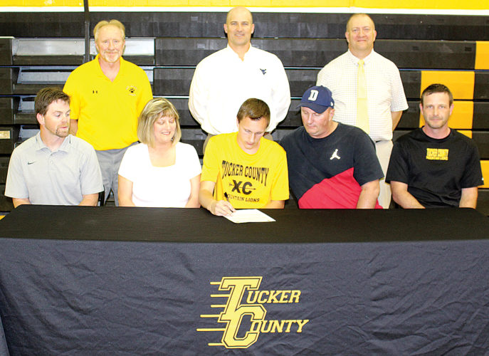 Tucker County's Josh Kincaid signs a letter of intent to run cross country and track at Potomac State College in Keyser. Pictured, back row from left are, Athletic Director Dave Kyle, Principal Jay Hamric and Assistant Principal Steve Cosner; and front row from left, track coach Shane Eakle, Teresa Kincaid, Josh Kincaid, Cliff Kincaid and cross country coach Dave Nelson.