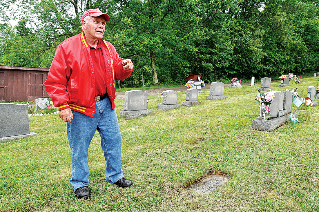 Elkins veteran Roger Ware stands Friday near the grave of his friend, Lance Cpl. Dennis Baxter, at Little Arlington Cemetery in Cravensdale. The Elkins friends served in the same location in Vietnam for two short months before Baxter was killed.