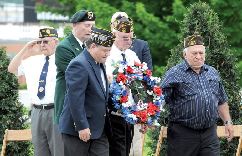 Military veterans place a wreath at the All-Veterans Memorial on Monday to celebrate Memorial Day. See additional photos on Page A8.