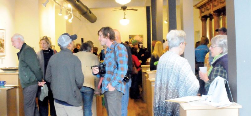 The Inter-Mountain photo by Baylie Helmick Community members, artists, sponsors and musicians gathered to mingle at Cottrill's Opera House for the opening of the ArtSpring weekend.