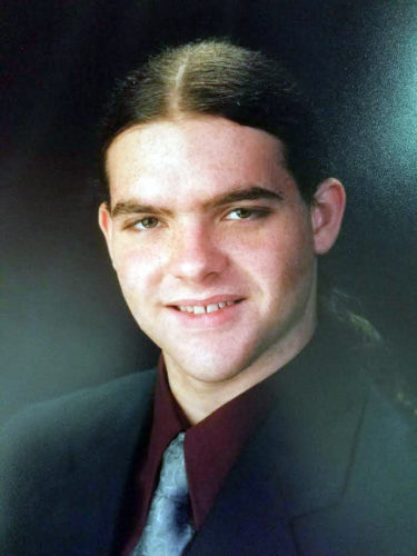 Kidney donor Ian Clark's senior picture, taken a year before he was killed in an automobile accident.