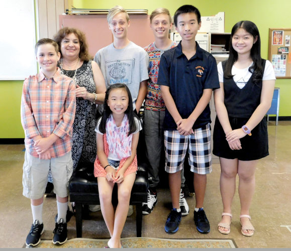 The Inter-Mountain photo by Angelea Goodwin Taking part in a piano recital concert at Davis & Elkins College Tuesday were, front row from left, Miles Maynard, Amy Dong, Anthony Dong and Cindy Zhu; and second row from left, instructor Mrs. Donna Baroudi Huffman, Austin Elliott and Aaron Elliott.