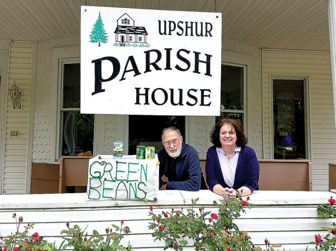 Submitted photo Dr. Joseph Reed, founder of Green Bean Day, and Alicia Rapking, Parish House director pose with cans of green beans.