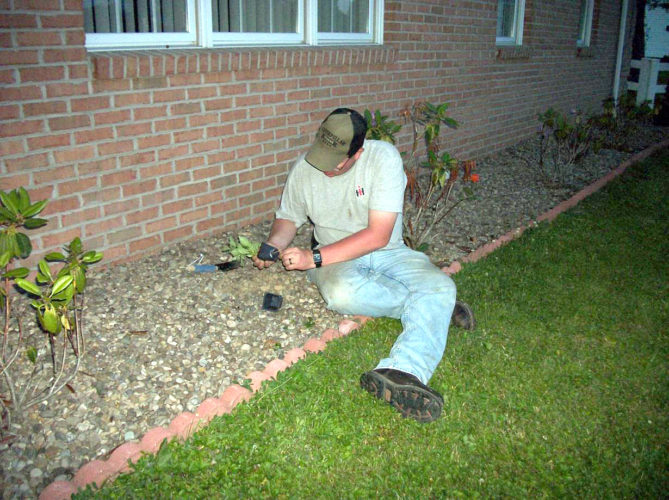 Submitted photo Valley Livestock 4-H Club leader Jaime Swecker plants annuals in a library flower bed.