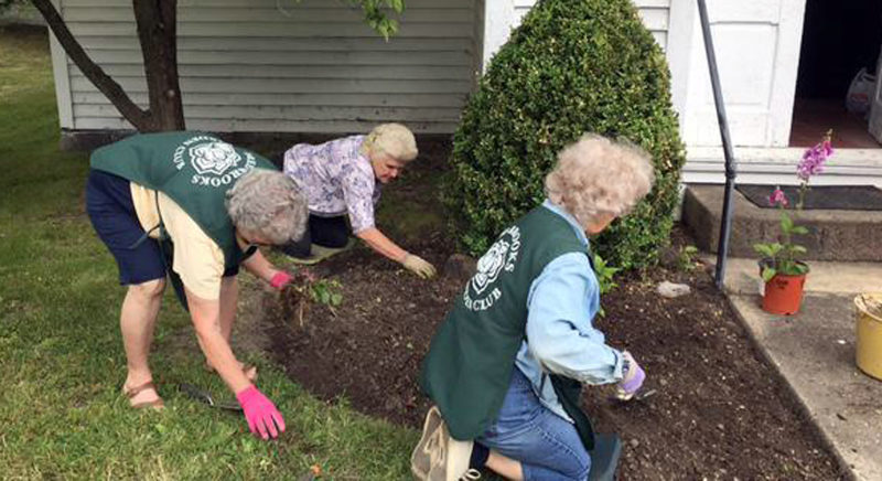 Submitted photo Working on planting flower beds are club members Naomi Matthey, Helen Heater and Sandra McCutcheon. Club president Patty McComas also participated in the planting.