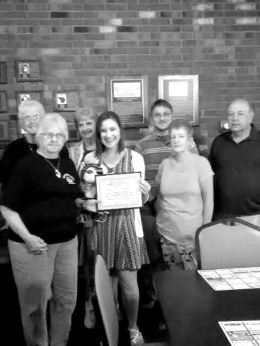 Emily Grace Chewning is awarded the 'Duck' Grimm Scholarship from the Elkins High School Alumni Association. Front row from left are Deloris Wilfong, Chewning and Jennifer Moats; and back row from left, Norma Fitzwater, Doris Williams, Nick Chewning and Richard Hyson.