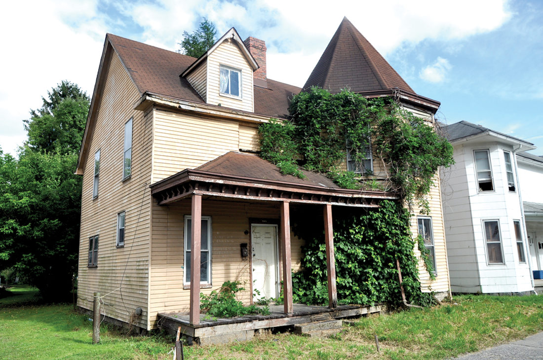A group of concerned citizens met this week to bring attention to abandoned, dilapidated structures, like this home on South Davis Avenue in Elkins.