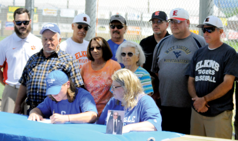 The Inter-Mountain photo by Brad Johnson Post 29 outfielder Luke Petrice signs a letter of intent  to play baseball at Glenville State College next season. Those attending the ceremony are, front row, Luke and his mother, Nicky Petrice; and second row, his uncle, Tom Petrice, his aunt, Christina Tenney, and his grandmother, Lucy Petrice, and back row, from left, Elkins High School football coach Evan Hott, EHS assistant coach Rocky Vannoy, Elkins Babe Ruth league coaches Mark Bennett and Chris Broughton, Elkins Post 29 Manager Chris George and EHS baseball coaches Jack Crumm and Joe Ross. Petrice's father, Vince Petrice, was unable to attend.