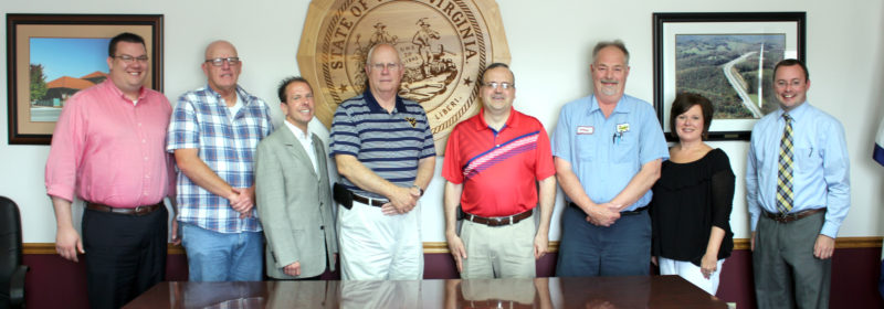 The Inter-Mountain photo by Brooke Binns Meeting to plan an Independence Day celebration are, from left, Elkins-Randolph County Chamber of Commerce Vice President Robbie Morris, Elkins Mayor Van Broughton, Davis & Elkins College Vice President for Student Affairs Scott Goddard, Randolph County Commission President Mike Taylor, Randolph Commissioners Mark Scott and Chris See, ERCCC Executive Director Wendy Hill and ERCCC President Hoy Ferguson.