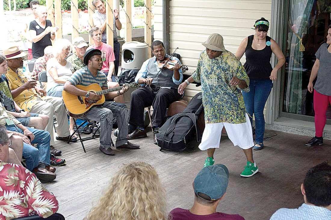 Submitted photo Halliehurst Porch on the campus of Davis & Elkins College is always filled with entertainment during the Augusta Heritage Center Summer Sessions.