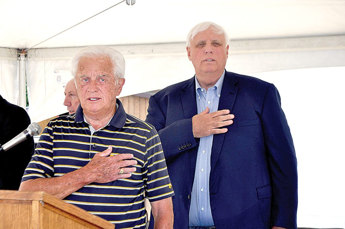Delegate Bill Hartman, left, leads the Pledge of Allegiance Saturday afternoon at the start of The Inter-Mountain's 125th Anniversary Celebration. Gov. James C. Justice is at the right of Hartman.