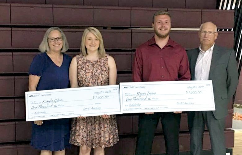 Submitted photo Two members of the Pocahontas County High School class of 2017 are the recipients of the Davis Medical Center and Davis Medical Center Auxiliary scholarships. Kayla Gibson, second from left, and Ryan Irvine, second from right, each was awarded $1,000 to further their education in the healthcare field. Both plan to attend West Virginia University this fall where Gibson will study biomedical engineering and Irvine will enter the nursing program. Presenting the scholarships are Scholarship Committee volunteers Diana and Rocky VanNoy. The Scholarship Committee, made up of two DMC Auxiliary members, a Davis Health System Board member, a local education representative and a local college representative, selects two recipients each year based on an application and essay. The scholarships are supported by the DMC Auxiliary and matching funds from DMC.