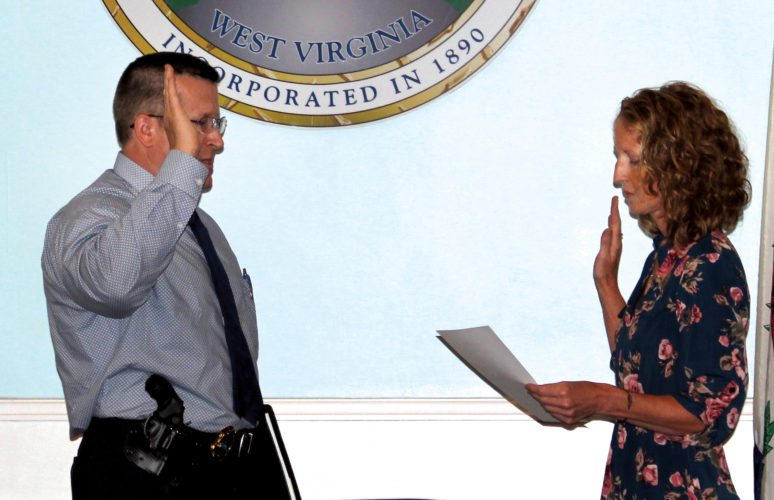 The Inter-Mountain photo by Brooke Binns New ElkinsPolice Department Chief Glenn Galloway is sworn in onMonday.