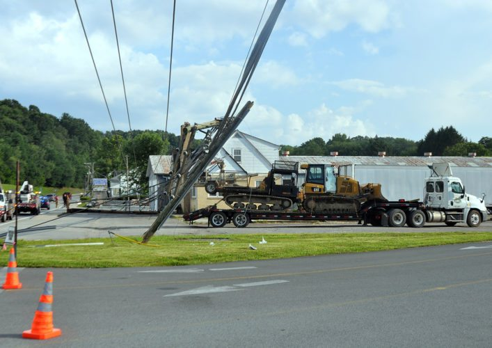 The Inter-Mountain photo by Anthony Gaynor A tractor trailer hauling heavy equipment struck utility lines and broke several poles along  North Randolph Avenue near the former Kelley Motors late Monday afternoon. The Elkins Fire Department and Elkins Police Department responded to the scene. According to FirstEnergy's outage website, at approximately 11 p.m. Monday there were 690 customers in Elkins, 140 in Kerens and 616 in Montrose without power.