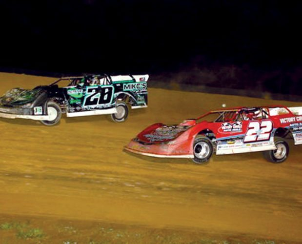 Submitted photo Tyler Carpenter, No. 28, won the seventh annual Skidmore Memorial race Saturday, with G.R. Smith, No. 22,  challenging him in the early laps.