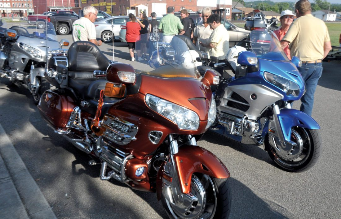 The Inter-Mountain photos by Beth Henry-Vance Thursday's kickoff event for the West Virginia Rally of the Gold Wing Road Riders Association West Virginia District attracts riders, motorcycle enthusiasts and community members to the Elkins Town Square. The group's rally will continue through this weekend.
