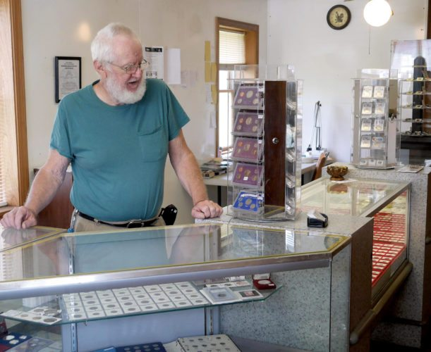Submitted photos Owner Roy Cutlip looks over some of the items at Cutlip Coins, his recently opened business in Beverly.