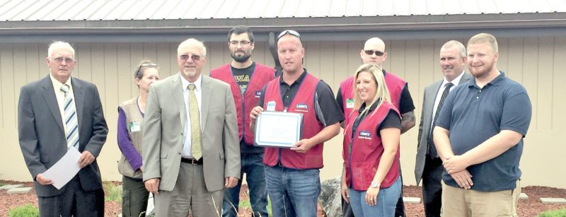 Submitted photo Upshur County Commissioners Terry B. Cutright, Samuel R. Nolte and Troy A. Brady III present Lowe's staff and volunteers with a 'Certificate of Recognition' for their efforts.