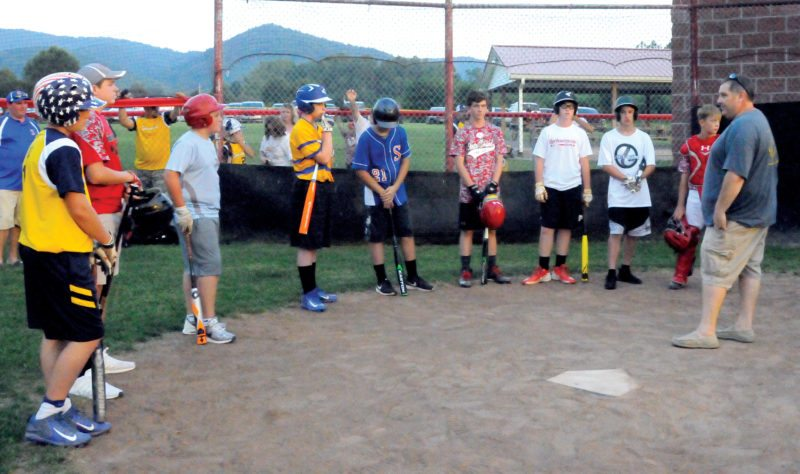 The Inter-Mountain photos by Angelea Goodwin A picnic and home run derby took place in Huttonsville Thursday night to kick off the 12-year-old Little League state tournament. Listening to home run derby instructions, are, from left, James Bell from Summersville, Bumby VanMeter from Grant, Andrew Lester from Sophia, Dawson Maynard from Logan, Levi Moore from Shinnston, Ezra Scott from Tygart Valley, Hayden Mattison from Barbour, Cameron Carney from Winfield, Riley Tackett from Tygart Valley, who was the catcher, and Dylan Burton from Huntington.