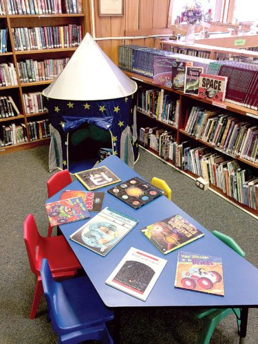 A rocket ship reading nook has been added to the children's reading area at the Elkins-Randolph County Public Library.  The space consists of a rocket-style tent, plush chair pillow and a flashlight for reading.