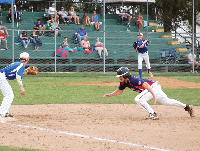 The Inter-Mountain photos by Brad Johnson Elkins Post 29 pitcher Matthew Gainer attempts to pick off Buckhannon Post 7's Mitchell Williams by throwing to first baseman Sam Ross Saturday.