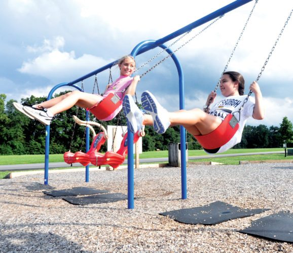 The Inter-Mountain photo by Beth Henry-Vance Olivia Sayres, left, and Kelly Suarez hang out Monday afternoon at Glendale Park in Elkins. The friends said they hope to spend more time together in the last few weeks before school starts again next month. In Randolph County, public schools are scheduled to resume Aug. 16.