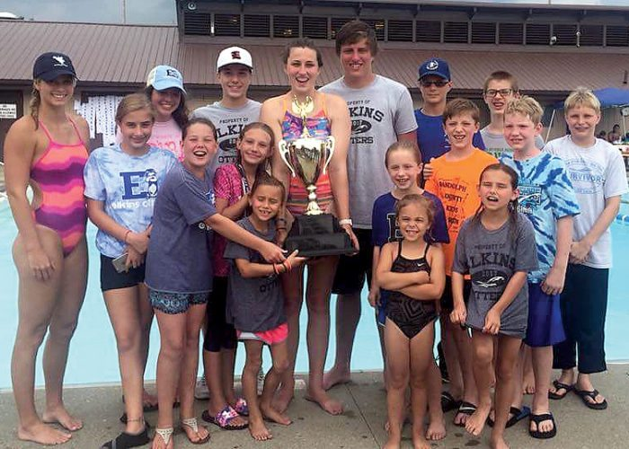 Submitted photo The Elkins Otters swim team display their first-place trophy at the 2017 North Central West Virginia Regional Swimming Championships.