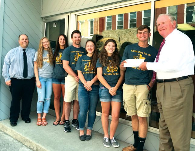 Submitted photos James W. Wallace, president of Allegheny Insurance, and Kevin Lambert, client service agent, proudly present $1,000 in matching funds to Tucker County FCA members Luke Poling, Natalie Evans, Cecily Strawderman, Shane Eakle, Sydney Nestor and Sydney Moore.