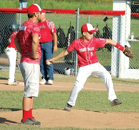The Inter-Mountain photo by Brad Johnson Tygarts Valley manager Davie Tackett watches as Riley Tackett warms up to pitch in relief Wednesday at the 2017 12-year-old Little League state tournament in Huttonsville.