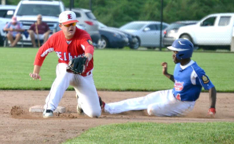 The Inter-Mountain photos by Tony Baisi Elkins Post 29 second baseman Rece Wamsley tries to snag a throw and make the tag on a Bridgeport baserunner Wednesday during the  opening game in the state tournament for both teams.