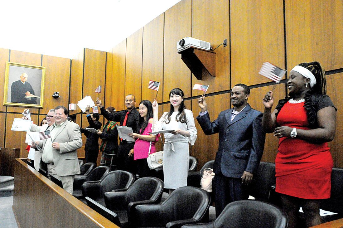 Ten men and women from all over the world celebrate their new U.S. citizenship Friday morning during a naturalization ceremony at the U.S. District Court in Elkins.