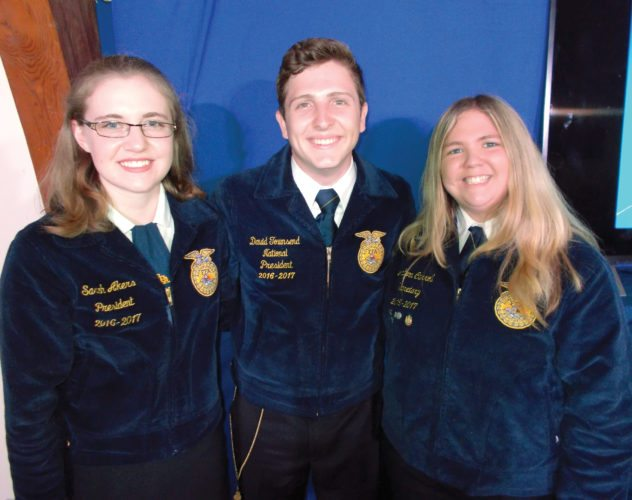 Submitted photos Sarah Akers, National FFA President David Townsend and Jaclynn Carroll at the State FFA Convention in July, where he presented them with their First Place AgriScience Fair Plaques.