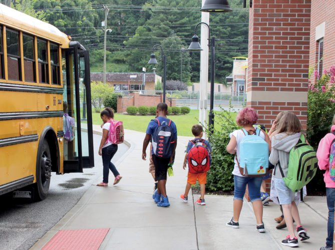 The Inter-Mountain photo by Brooke Binns Students in Upshur County returned to the classroom for the first day of the school year on Monday. Buckhannon Academy Elementary School students wrap up their school day and head home singing 'It's Raining, It's Pouring.'