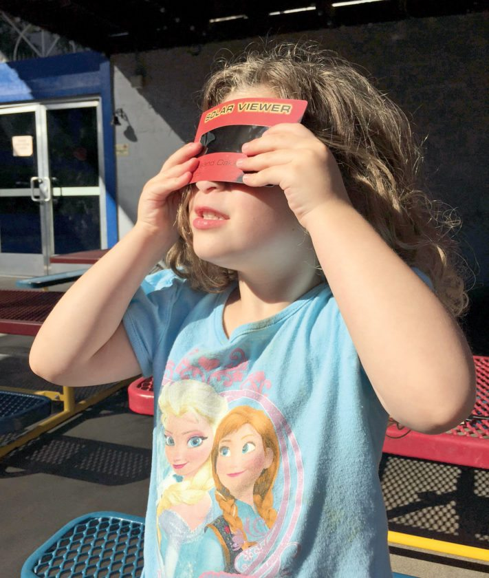 Submitted photo courtesy of Jay M. Pasachoff A solar eclipse is dangerously bright and should only be viewed through special-purpose 'eclipse glasses' or hand-held solar viewers that meet the ISO 12312-2 international standard for such products. Homemade filters or ordinary sunglasses, even very dark ones, are not safe for looking at the sun.