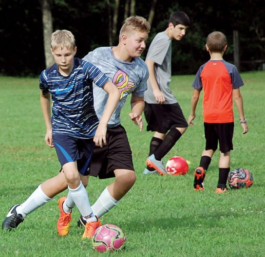 The Inter-Mountain photos by  Angelea Goodwin The Elkins Middle School boys and girls soccer teams have begun practice for the fall season. The EMS boys squad starts a practice this week with dribbling drills.