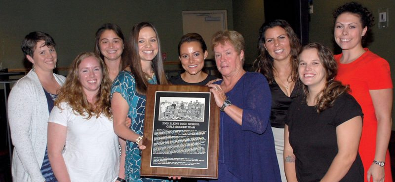 The Inter-Mountain photos by Brad Johnson Representing the 2005 undefeated state champion Elkins High School girls soccer team are, from left, Liz Barnes, Rachel Barnes, Lauren Elmer, Heather Saffel, Sydney Metheny, coach Nancy Saffel, Kirsten Marshall, Erica Tidwell and Abby Martin.