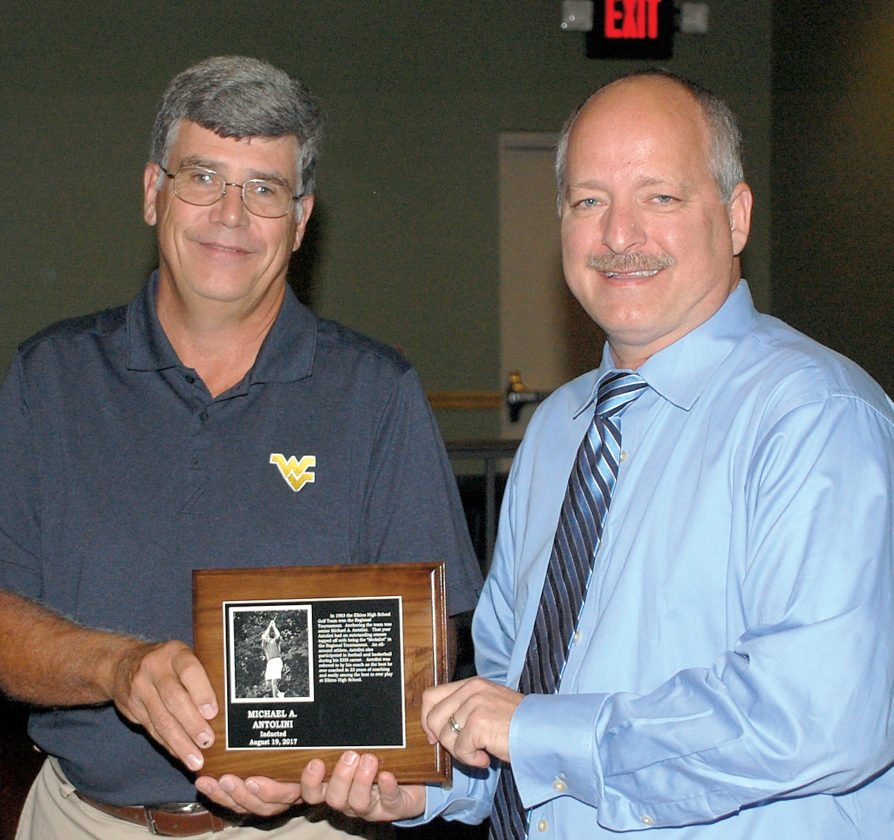 Former EHS golf coach Bob Wilmoth, left, congratulates Mike Antolini, who excelled on the links for the Tigers.