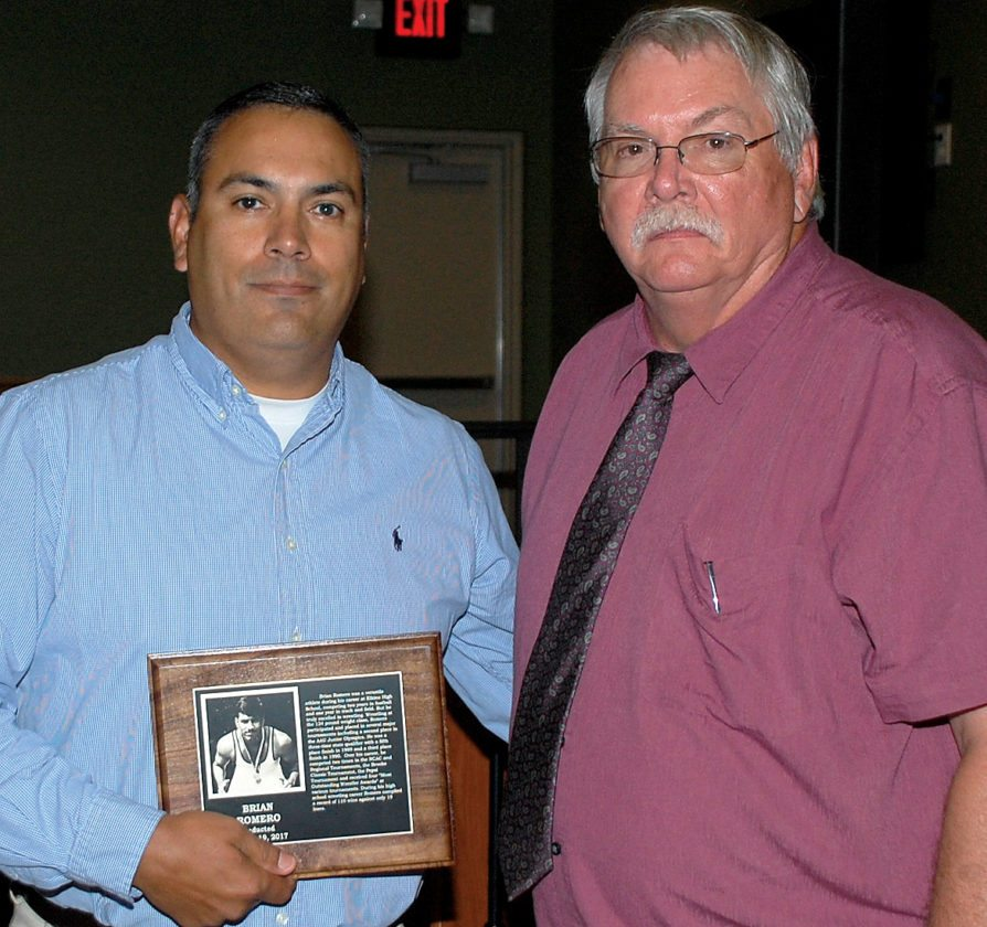 EHSwrestling standout Brian Romero, left, is congratulated by Hall of Fame President Dave Crawford.