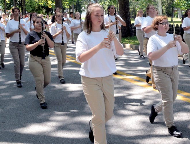 The Inter-Mountain photo by Tim MacVean Members of the Elkins High School 'Fighting Tigers' Marching Band make their way down Sycamore Street Saturday afternoon as they head toward the Elkins City Park as part of the 2017 Elkins Area Bands Auxiliary Corn Roast. Performances during the event included the EHS marching band, which consists of 106 members this year, as well as both the Elkins Middle School seventh- and eighth-grade bands. See more photos on Page A6.