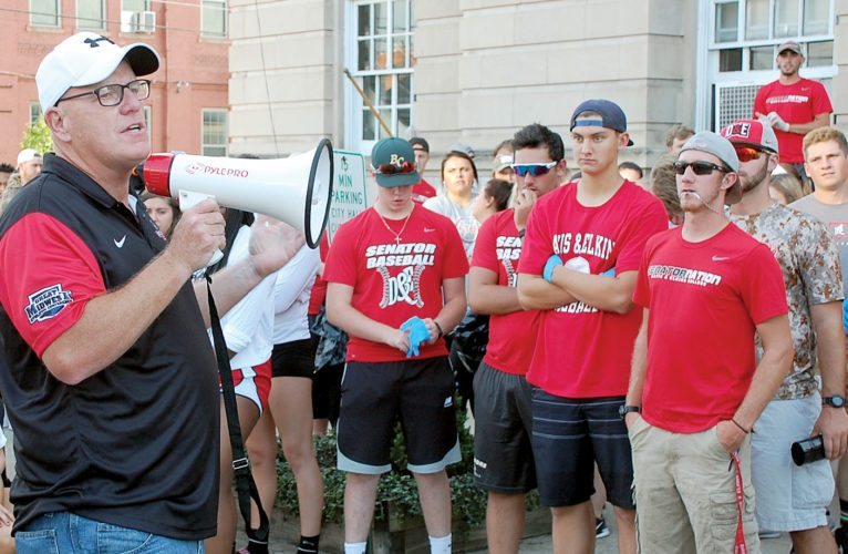 The Inter-Mountain photo by Brad Johnson Elkins Mayor Van Broughton addresses more than 300 Davis & Elkins College student athletes Monday evening in front of City Hall. The athletes took part in a service project picking up trash and weeding in different locations in downtown Elkins. More photos and information from the event will be featured in Saturday's edition of The Inter-Mountain.