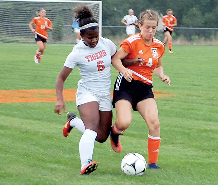 The Inter-Mountain photo by Brad Johnson Elkins' Nonee High, left, fights for the ball with a South Harrison player Tuesday. EHStook the victory, 4-1.