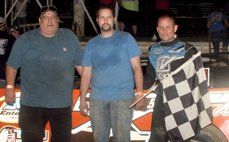 Submitted photo Paul Wilmoth Jr. took the checkered flag in the Jenkins Ford Super Late Models race Aug. 18.