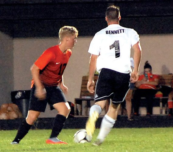 The Inter-Mountain photo by Angelea Goodwin Elkins' Justin Parsons, left, and a South Harrison player race to the ball Tuesday evening.