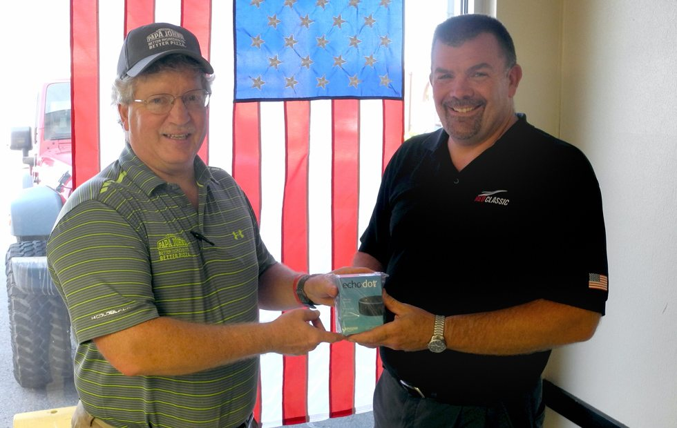 The Inter-Mountain photo by Beth Henry-Vance Chad Harman, right, of Harman, is the winner of an Echo Dot voice-controlled tech device, presented Monday by Mike Ellis, past president of the Rotary Club of Elkins, following Saturday's Community and Blood Health Screening. The Rotary Club sponsors screening events each February and August in conjunction with Davis Medical Center, and they take place at the First United Methodist Church in Elkins.